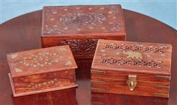 Sale 9103M - Lot 518 - A group of three carved timber boxes with floral motifs.