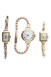 Sale 8315 - Lot 338 - THREE LADYS VINTGAE GOLD WRISTWATCHES; one 18ct with white dial, Roman numerals and blued hands to movement marked Buren (not worki...