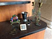 Sale 8313A - Lot 39 - A collection of Judea items, including a menorah, candle sticks, wine cups, serviette holder
