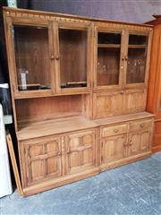 Sale 8740 - Lot 1191 - Pair of Ercol Golden Dawn Two-Piece Bookcases