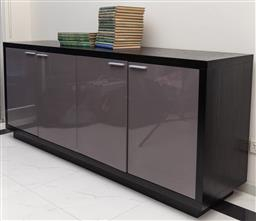 Sale 9162H - Lot 52 - A black oak credenza with four glossed doors opening to reveal shelved interior, Height 85.5cm x Width 200cm x Depth 50cm