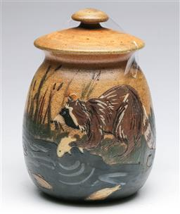 Sale 9185 - Lot 70 - American Woodland Pottery Salt Glazed Jar and Cover depicting racoon capturing fish, H: 19 cm