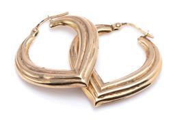 Sale 9194 - Lot 527 - A PAIR OF 9CT GOLD HEART HOOP EARRINGS; size 29.5 x 27mm heart shape with reeded pattern, wt. 2.75g.