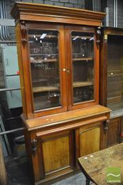 Sale 8359 - Lot 1051 - A Late 19th Century Cedar Bookcase with 2 glass panel doors long drawer and 2 panel doors, with pine secondaries (2 x Keys in Office)