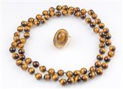 Sale 8369A - Lot 365 - Tigers eye necklace together with a tigers eye ring of contemporary design