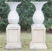 Sale 8422A - Lot 51 - A pair of white painted cast iron pineapples raised on square form stoneware bases, total height 79cm