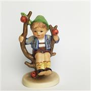 Sale 8456B - Lot 45 - Hummel Figure of a Boy Seated in an Apple Tree