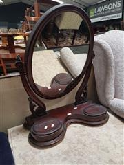 Sale 8666 - Lot 1094 - Victorian Mahogany Toilet Mirror, the oval mirror on carved supports, the serpentine base fitted with two compartments