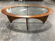 Sale 8967 - Lot 1077 - Oval G Plan Teak Coffee Table with a Glass Top (H:42 W:122 D:65cm)