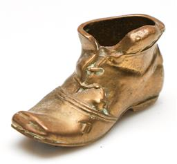 Sale 9246 - Lot 13 - A solid brass figure of a boot, Peerage, England (L:7.5cm)
