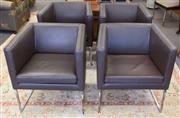 Sale 8310A - Lot 68 - Four well upholstered contemporary leather waiting chairs on stainless bases.