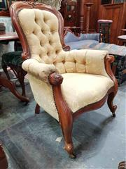 Sale 8925 - Lot 1084 - A carved timber and button back gold upholstered easy chair