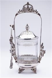 Sale 9015J - Lot 129 - An antique American Derby silverplate and crystal pickle jar and stand, C: 1900. The stand having extensive pierced floral decoratio...