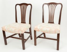 Sale 9150J - Lot 19 - A pair of George III mahogany English side chairs C: 1780. The camel top rails centred to splayed pierced splats raised on large sha...