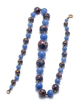 Sale 9213 - Lot 361 - A VINTAGE BLUE GLASS BEAD NECKLACE; graduated strand of 5.5-16mm round blue and polychrome beads featuring roses to a bolt ring clas...