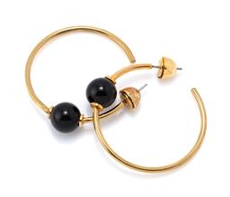 Sale 9221 - Lot 355 - A PAIR OF SARINA SURIANO MARS CIRCULUS ONYX HOOP EARRINGS; 1.7mm wide hoops in 18ct gold plate each attached with a 10.4mm round ony...