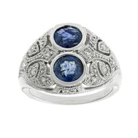 Sale 8221A - Lot 45 - Deco Style Platinum and Diamond Ring; pierced top set with two round blue sapphires, and twelve round brilliant cut diamonds, Size N-O