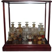 Sale 8342A - Lot 10 - An timber showcase containing 19 antique appothecary jars, 56 x 55 x 30cm.