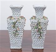 Sale 8440A - Lot 4 - A pair of continental porcelain floral encrusted vases marked to base EBS 2774-2 and painted blue anchor, H 20cm