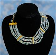 Sale 8577 - Lot 115 - A vintage five strand borealis crystal necklace with gold and diamante crystal log spacers and borealis crystal loop, L 46cm, Condit...