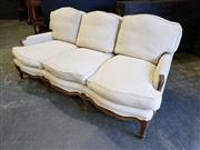 Sale 8993 - Lot 1020 - Louis XV Style Carved Walnut Frame Three Seater Settee, upholstered in beige linen fabric & on cabriole legs (H: 90 x L: 205 x D: 90cm)