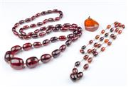 Sale 8369A - Lot 334 - Graduated amber bead necklace together with another example and an amber pendant