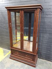 Sale 9014 - Lot 1048 - Contemporary Olivewood Display Cabinet, with two bevelled glass panel doors & a long drawer (H:198 W:109 D:50cm)