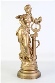 Sale 8905S - Lot 639 - A gilded spelter figure of a harp player. Height 49cm