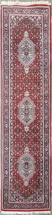 Sale 8971 - Lot 1062 - A Woollen Persian Runner on red ground with blue boarder (314 x 83cm)