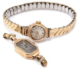 Sale 9124 - Lot 516 - TWO VINTAGE 9CT GOLD LADYS WRISTWATCHES; a Cyma with 17 jewel manual movement, gold plated band (working), other with a 15 jewel Swi...
