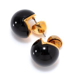 Sale 9221 - Lot 397 - A PAIR OF SARINA SURIANO CAVA ONYX STUD EARRINGS; 14mm round 3/4 onyx spheres in 18ct gold plate, w. 9.17g, new in box with care card.