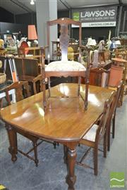 Sale 8257 - Lot 1057 - Timber Dining Setting incl. Table on castors & Six Stretcher Based Chairs incl. two carvers
