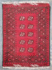 Sale 8971 - Lot 1048 - Small Woollen Turkoman, in red and black - Made by Hali Handmade Carpets (110 x 75cm)