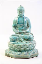 Sale 8997A - Lot 696 - Glazed oriental seated buddha (H23cm)