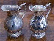 Sale 8310A - Lot 72 - A pair of matching silverplate water jugs by Sheffield of Chelsea. Height 21cm
