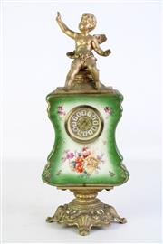 Sale 8905S - Lot 642 - A German porcelain mantle clock with cherub finial (AF). Height 35cm