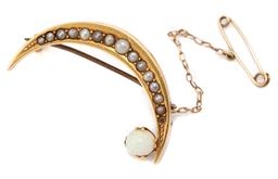 Sale 9107J - Lot 358 - AN ANTIQUE 15CT GOLD OPAL AND PEARL CRESCENT BROOCH; 40mm long crescent set with seed pearls (1 missing, 1 faux replacement) attache...