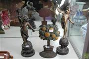 Sale 8217 - Lot 77 - Bronze Cupid Figures & a Cast Metal Tree Form Door Stop