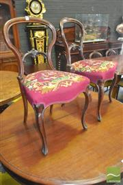 Sale 8267 - Lot 1080 - Set of Four Victorian Rosewood Balloon Back Chairs, delicately carved, with red tapestry seats & cabriole legs