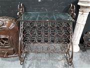 Sale 8843 - Lot 1005 - Scrolled Metal Wine Rack with Glass Top