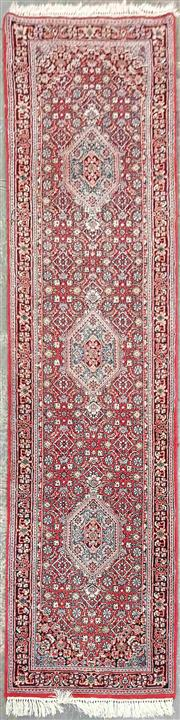 Sale 8971 - Lot 1038 - A Hand Woven Persian Runner on red ground with blue border (320 x 81cm)