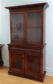 Sale 9070H - Lot 153 - A Victorian mahogany veneered bookcase the double glazed doors revealing two shelves over frieze drawer and two panel covered doors,...