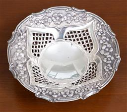 Sale 9140H - Lot 22 - A 925 silver tri footed bon bon dish with pierced gallery and embossed floral pattern, Diameter 17cm, Weight 133g