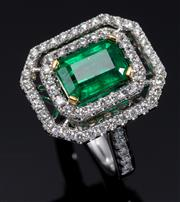 Sale 8912H - Lot 30 - AN 18CT GOLD EMERALD AND DIAMOND DRESS RING; faruring an approx. 2.50ct emerald cut emerald to a 2 row border and shoulders set with...