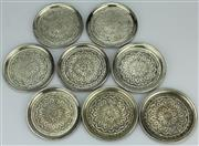 Sale 8139 - Lot 71 - Persian Silver Set of Eight Drink Coasters