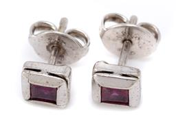 Sale 9124 - Lot 434 - A PAIR OF WHITE GOLD SOLITAIRE RUBY STUD EARRINGS; bezel set with carre cut treated rubies set in 7ct white gold, size 6.3 x 6.3mm,...