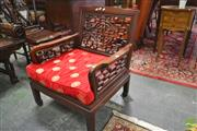 Sale 8255 - Lot 1008 - Pair of Chinese Rosewood Armchairs, the lattice work backs with Shou & red satin cushions