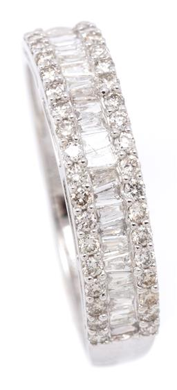 Sale 9132 - Lot 554 - AN 18CT WHITE GOLD HALF HOOP DIAMOND RING; centring a row of 23 tapered baguette cut diamonds between borders set with 36 round bril...