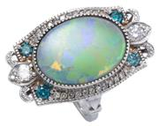 Sale 8999 - Lot 390 - AN EDWARDIAN STYLE OPAL AND GEMSET RING; centring an 18 x 13.7mm opal (some crazing) within a surround of 26 round brilliant cut whi...