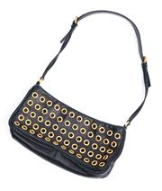 Sale 9054 - Lot 351 - A PRADA BLACK LEATHER EYELET BAGUETTE BAG; studded both side with gold tone hardware, flat leather strap, magnetic open top, and an...